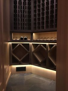 Wine Room Installation Vertical grain Fir panels and cabinets with American Black Walnut accents